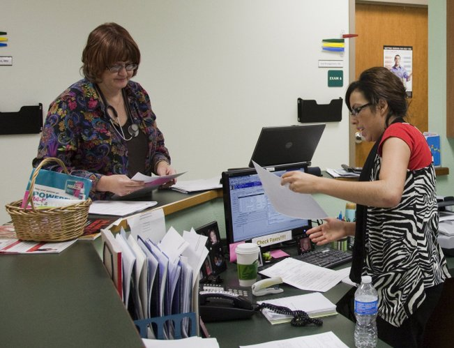 Nurse practitioner Cheryl Rajotte, left, goes over patient information with administration assistant Maggie Serrano  at the Community Health Center of Southeast Kansas in Pittsburg.