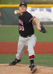 Lawrence High pitcher Alex Laughlin delivers against Leavenworth on Thursday, May 5, 2011 at LHS.