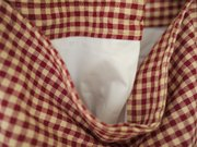 Since you can't press the shower curtain liner (without making a big, melted mess, that is), fold the facing up and topstitch it to the seam allowance. This will keep it flat. Repeat with the other facing and lining pieces.