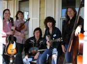 Three of the members of the Lawrence-based blue grass band MAW are mothers.