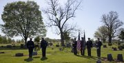 The Lawrence police honor guard stand in silence at the grave of Officer Allen Moore during a wreath-laying ceremony Friday, May 6, 2011. Three fallen police officers and a firefighter were honored in observance of Kansas Law Enforcement Officers Memorial Day.