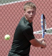 Free State junior Andrew Craig keeps his eyes on the ball during singles play Friday, May 6, 2011 at the boys 6A regional tennis tournament, hosted by Lawrence High.