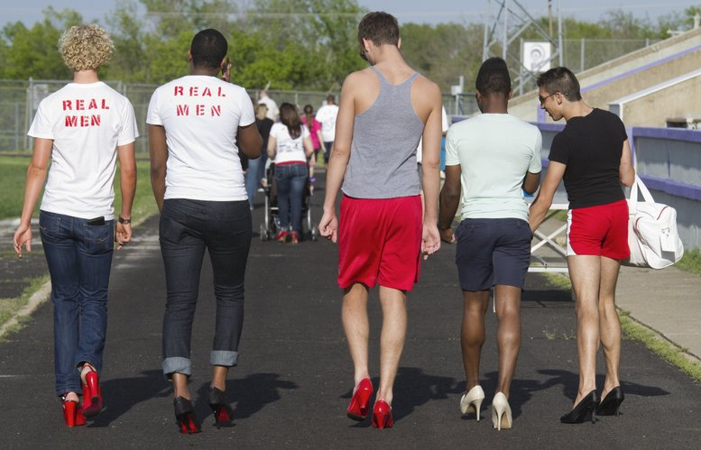 "Members of the Delta Lambda Phi fraternity participate in the Willow Domestic Violence Center's ""Walk a Mile In Her Shoes: Red Shoe Walk"" fundraiser Friday, May 6, 2011, at Haskell Stadium. From left, are Alex Earles, Randy Thompson, Connor Stanton, Godfrey Riddle and Sheldon Padilla."
