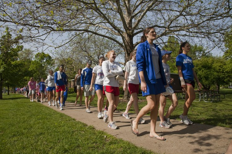 The Kansas University women's volleyball team lead the way during the Lawrence Arthritis Walk on Saturday, May 7, 2011. The walk started in South Park and headed down Massachusetts Street. The event raised awareness about arthritis and money for the Arthritis Foundation. About 100 people participated.
