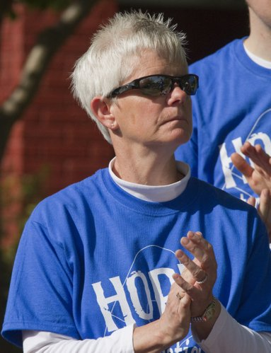 Jane Harris, Lawrence, applauds honorees during the sixth annual Lawrence Arthritis Walk on Saturday, May 7, 2011, in South Park. Harris is co-chair of the event. She volunteers to help with the walk in memory of her mother, Ilene Harris, who had rheumatoid arthritis.