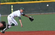Free State senior Dylan Perry reaches for a ground ball in the first inning against Lawrence High on Monday, May 9, 2011 at FSHS.