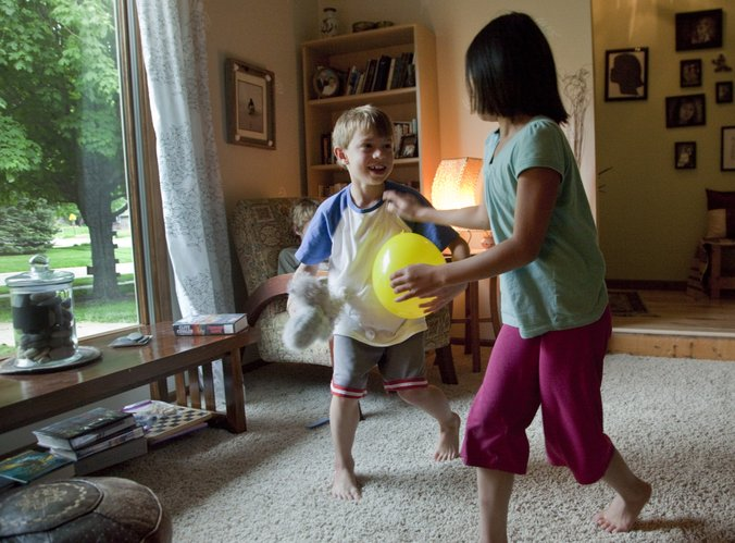 Matt Reimer, a student at Deerfield Elementary School, plays with his sister Lucy in their Lawrence home Wednesday, May 11, 2011. Matt has been diagnosed with X-Linked Childhood Adrenoleukodystrophy and has been accepted by the Kennedy Krieger Institute in Baltimore to participate in the Lorenzo's Oil medical study to attempt prevention of cerebral onset.