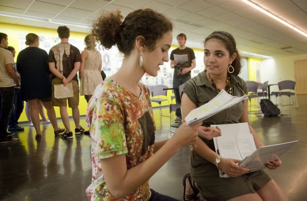 "Free State juniors Leslie Cunningham, foreground left, and Alexandra Hoopes, right, rehearse a scene from  ""Spring Awakening,"" a production of the Frank Wedekind play by the Lawrence Arts Center City Youth Theater's Wake Up Coalition."