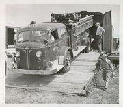 The brand new American LaFrance pumper truck is offloaded from a boxcar on March 16, 1955. This photo appeared on the front page of the Lawrence Daily Journal-World the next day. The pumper now sits at Douglas County Fire Medical's investigation center, 1839 Mass., awaiting restoration by current firefighters.