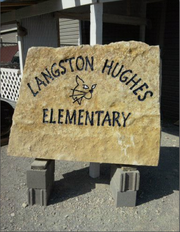A new sign is being created for display in front of Langston Hughes School, 1101 George Williams Way.