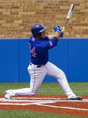 Kansas University's Alex DeLeon blasts a three-run homer in the bottom of the third inning in Game 1 of a doubleheader against Alabama A&M on Saturday, May 14, 2011 at Hoglund Ballpark.