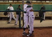 Free State pitcher Cody Kukuk and Joe Dineen console each other after losing in eight innings to Leavenworth, 5-3, in the 2011 6A regional baseball tournament championship game Wednesday, May 18, 2011 at FSHS.