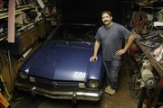 Kenny Eaton, Topeka, stands with his 1975 Ford Pinto, which he purchased three years ago. Eaton plans to participate in the Pinto Stampede, a cross-country rally that will be in northeastern Kansas May 29-30.