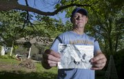 Lawrence resident Neal Ballard, who lives on the 1900 block of Learnard, is pictured with a receipt from Reading he found on Sunday afternoon in his backyard while preparing to mow his grass. Ballard thinks the receipt was delivered to his backyard by the tornado that struck Reading on Saturday.