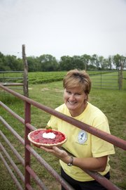 Jane Wohletz is pictured with a strawberry pie she made May 23 at Wohletz Farm, 1831 N. 1100 Road.