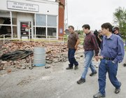 Kansas Gov. Sam Brownback, middle, walks with Mayor Lonnie Atchison, left, and Lt. Gov. Jeff Colyer past tornado damage in Reading Monday, May 23, 2011.