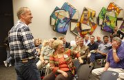 Senator Jerry Moran laughs during a meeting with Lawrence residents, hosted by the Lawrence Chamber of Commerce at the Lawrence Public Library. Moran came to Lawrence to discuss his opinions on issues including health care, immigration and conflicts overseas in addition to taking questions.