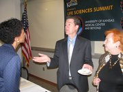 Gov. Sam Brownback speaks with Kansas University Chancellor Bernadette Gray-Little, left, and Executive Vice Chancellor Barbara Atkinson on Tuesday at the end of the governor's economic summit on life sciences.