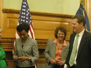 KU Chancellor Bernadette Gray-Little, state Sen. Carolyn McGinn, and Gov Sam Brownback on Wednesday share a laugh after Brownback signed into law measures aimed at increasing the number of engineering graduates in Kansas.