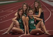 Members of the Free State girls 4x800 relay team, from left, Lynn Robinson, Rachael Schaffer, Hayley Francis and Bailey Sullivan will be participating in the Class 6A state meet, which starts today in Wichita.