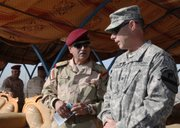 Col. Jeffrey Jerome, right, discusses security training operations with the commander of the 14th Iraqi Army Division, in Basra, Iraq. Col. Jerome is assigned to the 1-12 Charger Battalion, 3rd Advisory and Assist Brigade, 1st Cavalry Division.