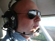 Seth Fox, owner of High Plains Inc., a liquor distillery in Atchison, said he flies for recreation.
