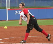 Lawrence High pitcher Lauren Massey tosses to Olathe East in the 6A state softball playoffs Friday, May 27, 2011 at Arrocha Ballpark.