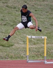 Free State's Danny Lee competes in the 300 hurdles Saturday, May 27, 2011, at the 6A state track meet in Wichita.
