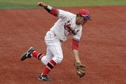 Lawrence High's Corbin Francisco scoops up a grounder in the sixth inning of a Class 6A state baseball semifinal. The Lions fell to Blue Valley West, 3-2, Saturday, May 28, 2011 at Hoglund Ballpark.
