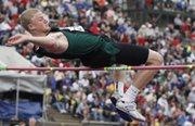 Free State's Austin Hoag clears the bar in the high jump. Hoag won the event Saturday, May 28, 2011 in Wichita.