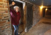 """""""The businesses they put down here were for men only,"""" says Bill Starr, owner of Starr Antiques, the Wolf Hotel and the Ellinwood Underground. Starr leads tours of the tunnels beneath Ellinwood."""
