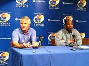 Kansas head coach Turner Gill, right, and defensive coordinator Carl Torbush address the media at a press conference in which Torbush retired from KU and college football Tuesday, May 31, 2011 after being recently diagnosed with low grade prostate cancer.