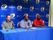 Kansas head football coach Turner Gill, center, introduces Vic Shealy, left, as KU's new defensive coordinator after Carl Torbush stepped down for medical reasons. Buddy Wyatt, right, was promoted to co-defensive coordinator. The coaches addressed the media Tuesday, May 31, 2011 at the Anderson Family Football Complex.