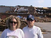Diane and Justin Lewis in front the remnants of a Dillons damaged by the tornado that swept through Joplin, Mo., May 22, 2011.