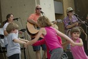 Music and dancing were some of the offering at the first Brown Bag Concert June 2, 2011, in front of the U.S. Bank, 900 Massachusetts Street. Billy Spears and the Beer Bellies kicked things off along with band members, from left, vocalist Carol Spear-Latham, guitarist Mike Schwartzburg and Billy Spears on fiddle.