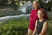 Amber and Jeremy Lehrman have harvested more than 1,000 pounds of food each year for the past three years from their organic garden in southwest Lawrence.