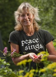 Kirsten Bosnak has created a garden area in her North Lawrence home that offers a variety of medicinal plants as well as a selection of vegetables.