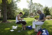Tracy Sanson, left, of Phillipsburg, and Anne Brumbaugh, Overland Park, painted outdoor scenes near the Chancellor's residence Monday, June 6, 2011, on the Kansas University campus. Sanson and Brumbaugh were participating in the College of Liberal Arts and Sciences' annual Mini College.