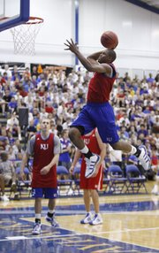Ben McLemore pulls back for a dunk during warmups and prior to the start of the alumni scrimmage game on Wednesday, June 8, 2011 at the Horejsi Center.
