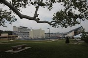Moving back a couple feet and incorporating a low hanging tree branch, adds some visual interest to a Memorial Stadium photograph and directs the viewer into the image.