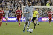Sporting KC Forward Teal Bunbury, front, takes the ball downfield in the first half. Sporting KC and Chicago tied, 0-0, on Thursday in Kansas City, Kan.