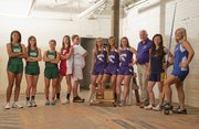 The All-Area girls track & field first team, from left, is: Alexa Harmon-Thomas, Free State; Lynn Robinson, Free State; Hayley Francis, Free State; Jenny Whitledge, Tonganoxie; Domino Grizzle, Tonganoxie; Morgan Lober, Baldwin; Lyndsey Lober, Baldwin; Kaitlyn Barnes, Baldwin; coach Ted Zuzzio, Baldwin; Shereen Fattaahi, Veritas Christian; Jordan Miller, Oskaloosa.
