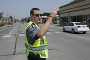 Lawrence police officer Jason Novotny, directs traffic at Ninth and Mississippi streets around 3:00 p.m., after a power outage caused about 5,000 Westar customers to be without power Friday, June 10, 2011. A substation at Sixth and Kentucky streets had a circuit overload, which caused a switch to fail.