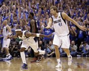 Dallas guard Jason Terry and Dirk Nowitzki (41) celebrate after Terry hit a three-pointer in the closing seconds of Game 5 of the NBA finals. The Mavs took a 3-2 series lead with a 112-103 win on Thursday in Dallas.