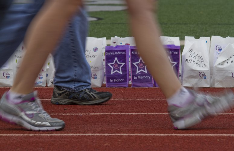 Luminarias lined the track during the 2011 Relay For Life of Douglas County at Free State High School. There were 2,950 at the event.