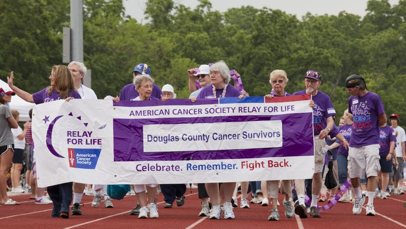 Cancer survivors kick off the start of the 2011 Relay For Life of Douglas County at Free State High School.