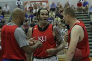 Former Jayhawks, from left, Drew Gooden, Scot Pollard and Cole Aldrich huddle up before scrimmaging against KU's current team at Bill Self's basketball camp on Wednesday, June 15, 2011.