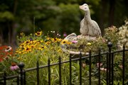 A flower garden in back of Ellen and Howard Duncan's house is filled with color and contained by its own fence.