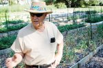 Shawnee resident Warren Messinger explains his organic gardening practices to a visitor. Messingers garden at 6131 Long Ave. is the only stop in Shawnee  and one of just three in Johnson County  on this weekends Kansas City Urban Farms &amp; Gardens Tour.