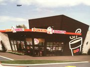 A picture on the sign at Sixth and Michigan streets announcing a new Dunkin' Donuts for the location.